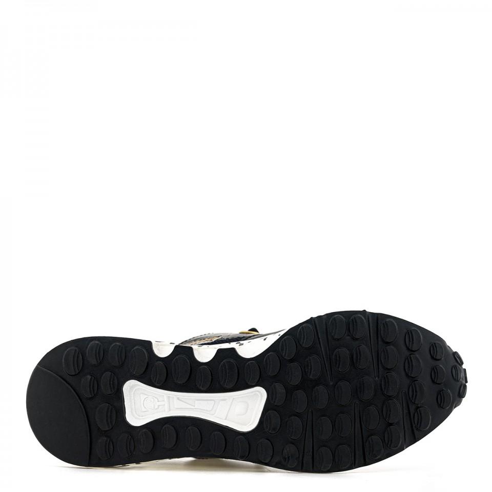 Czarne sneakersy na wysokiej podeszwie ze zwierzęcymi wstawkami