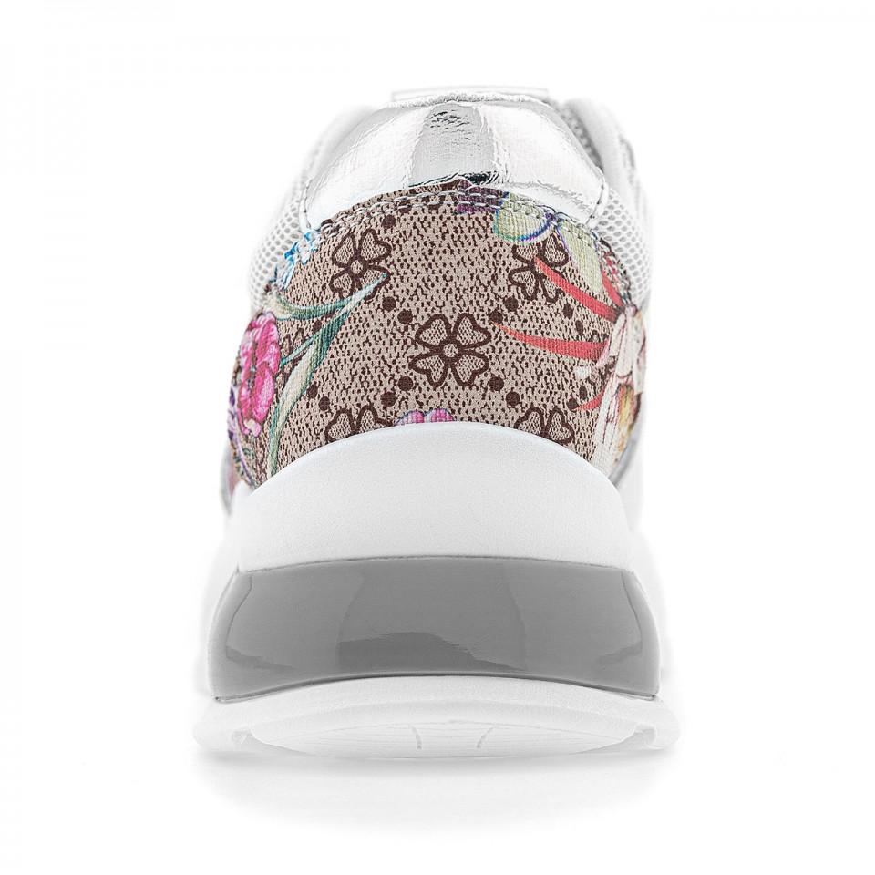 Białe damskie sneakersy na wygodnej podeszwie zdobione kwiatami i brokatem